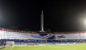Fans of Nacional display a giant flag during Copa Libertadores match against Mexico's Toluca in Montevideo