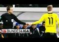 Marco Reus leva árbitro assistente à frente