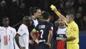 Paris Saint-Germain's forward Zlatan Ibrahimovic is shown a yellow card in the match against Lille