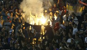 1413317353560_wps_65_Fans_of_Serbia_burn_a_NAT